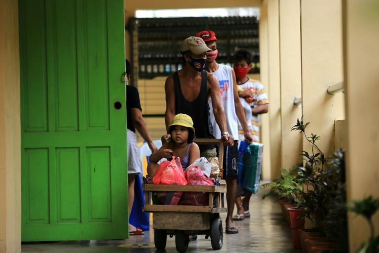 Residents fleeing Super Typhoon Goni arrive at an evacuation center in Legazpi south of Manila -- nearly a million people have left their homes ahead of the storm's arrival