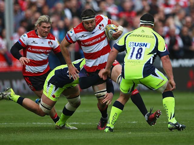 Jeremy Thrush tries to make his way through the Sale defence (Getty)