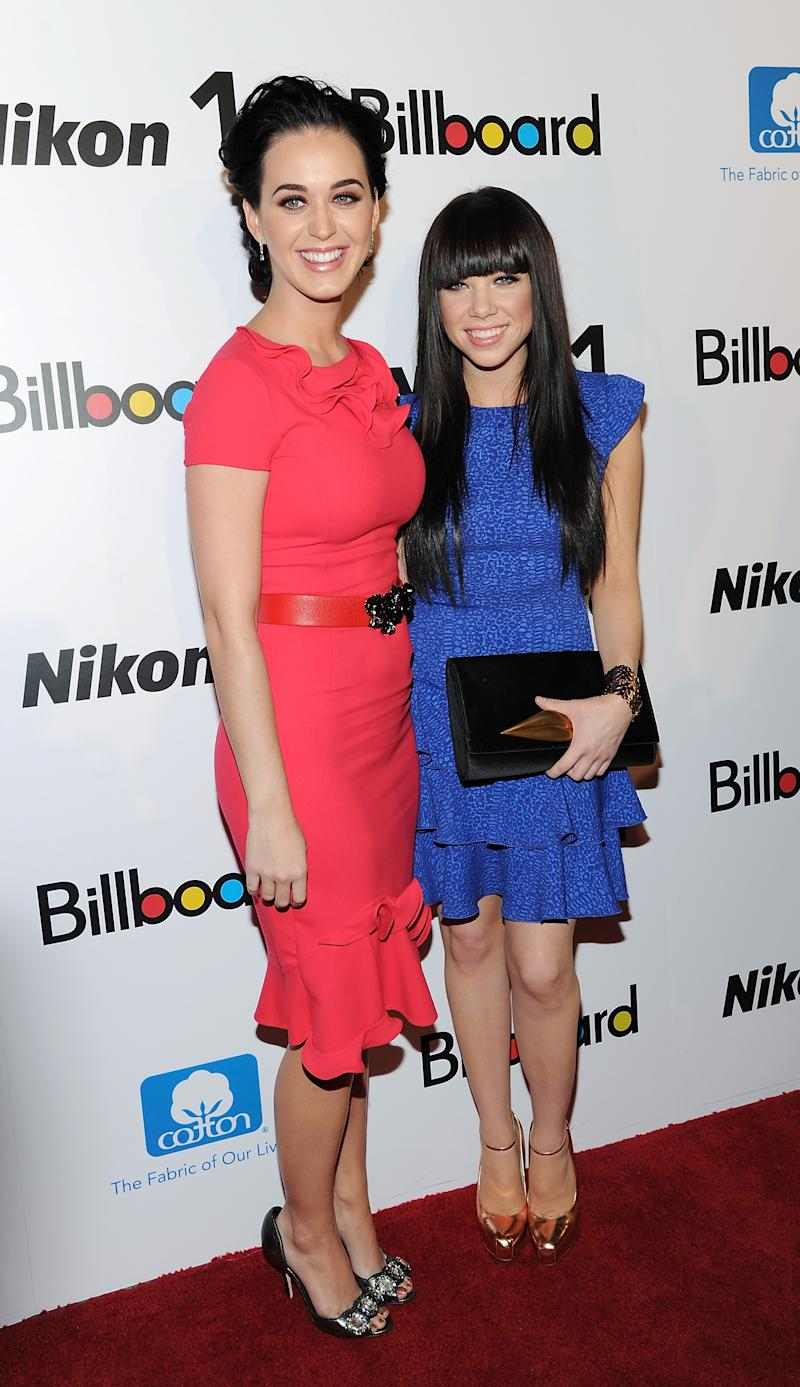 """""""Woman of the Year"""" honoree Katy Perry, left, and """"Rising Star"""" honoree Carly Rae Jepsen pose together at Billboard's """"Women in Music 2012"""" luncheon at Capitale on Friday Nov. 30, 2012 in New York. (Photo by Evan Agostini/Invision/AP)"""