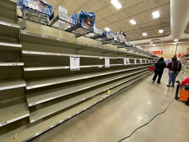 Grocery store shelves are empty in the Austin area after a winter storm swept across Texas. Most businesses were closed for several days.