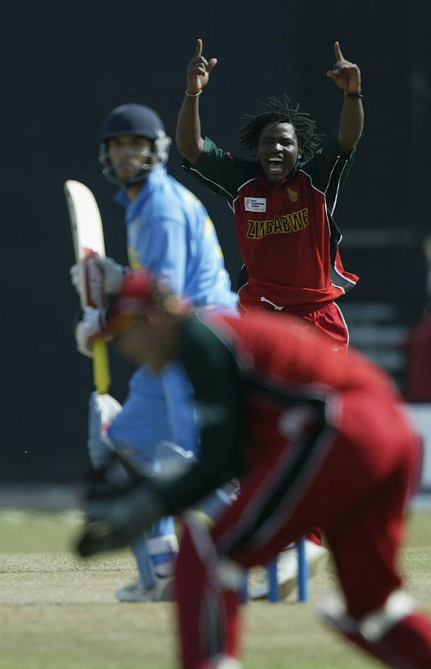 COLOMBO - SEPTEMBER 14:  Douglas Hondo of Zimbabwe celebrates dismissing Yousuf Youhana of India during the ICC Champions Trophy match between India and Zimbabwe at the Premadassa Stadium in Colombo, Sri Lanka  on September 14, 2002. (Photo by Clive Mason/Getty Images.)