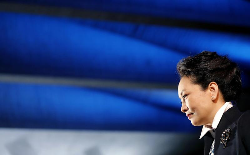 The wife of Chinese President Xi Jinping, Peng Liyuan looks on during a visit at the UNESCO headquarters, in Paris, Thursday March 27, 2014. Deal-making and commemorations of a half-century of French diplomatic ties with Communist China were the order of business during Xi's three-day visit, part of his European tour.(AP Photo/Christian Hartmann)