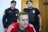 FILE- In this file photo taken on Thursday, Aug. 22, 2019, Russian opposition leader Alexei Navalny speaks to the media prior to a court session in Moscow, Russia. The German government says specialist labs in France and Sweden have confirmed Russian opposition leader Alexei Navalny was poisoned with the Soviet-era nerve agent Novichok. (AP Photo/Alexander Zemlianichenko, File)