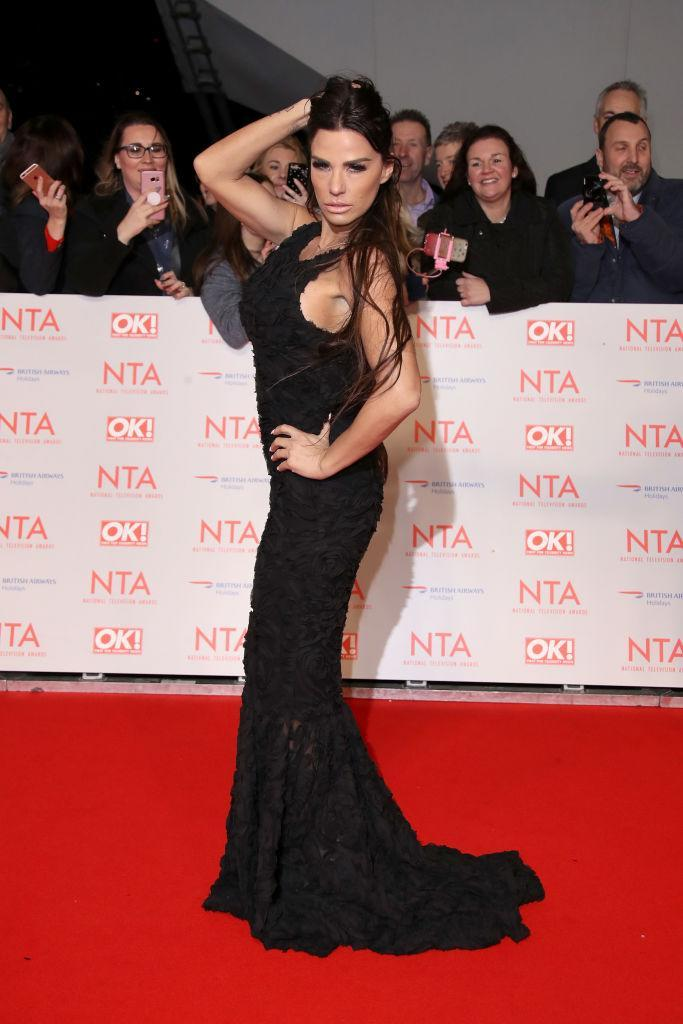 <p>Trust Katie Price to pose up a storm on the red carpet. The 'Loose Women' presenter donned a black fishtail gown for the awards ceremony. <em>[Photo: Getty]</em> </p>