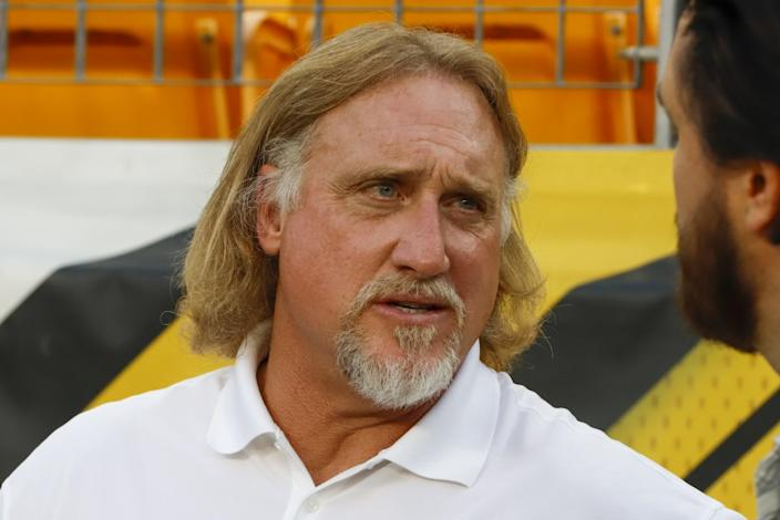 Pro Football Hall of Fame outside linebacker Kevin Greene stands on the sidelines during warmups.