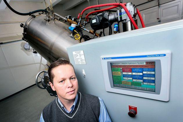 Trevor Charbonneau, a funeral home owner in Toronto, with his company's alkaline hydrolysis machine. (Photo: Andrew Francis Wallace/Getty Images)