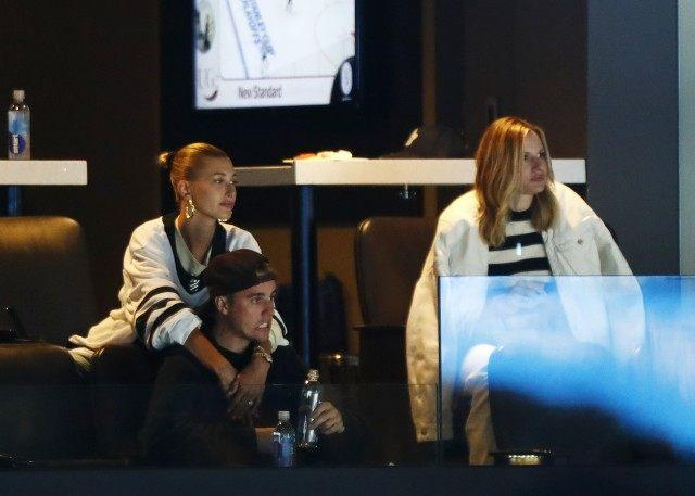 Justin Bieber reacts and wife Hailey Rhode Bieber looks on during Game Seven of the Eastern Conference First Round during the 2019 NHL Stanley Cup Playoffs between the Boston Bruins and the Toronto Maple Leafs at TD Garden on April 23, 2019 in Boston, Massachusetts.