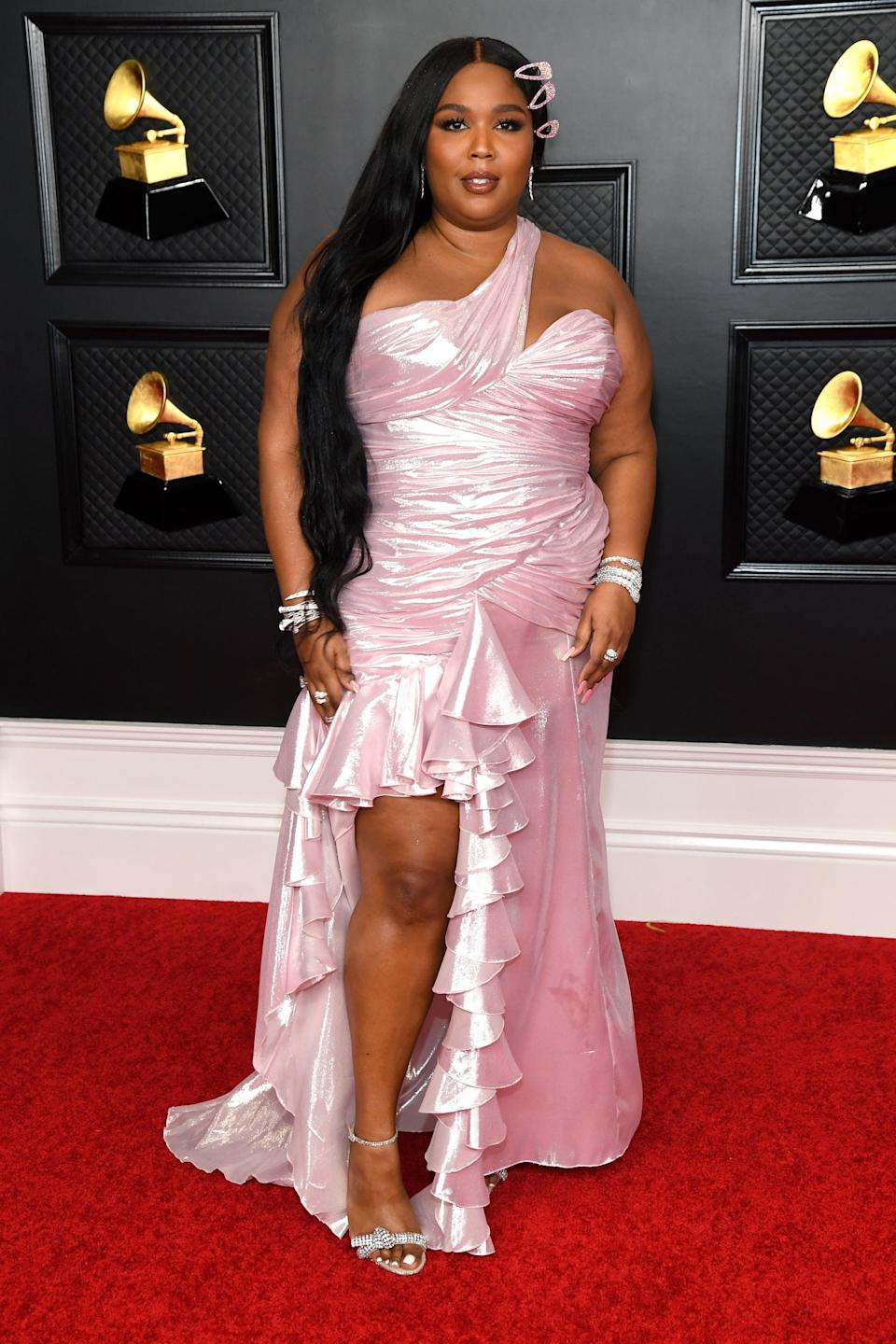 <p>Wearing a Balmain dress with Jimmy Choo shoes and Bvlgari jewels.</p>