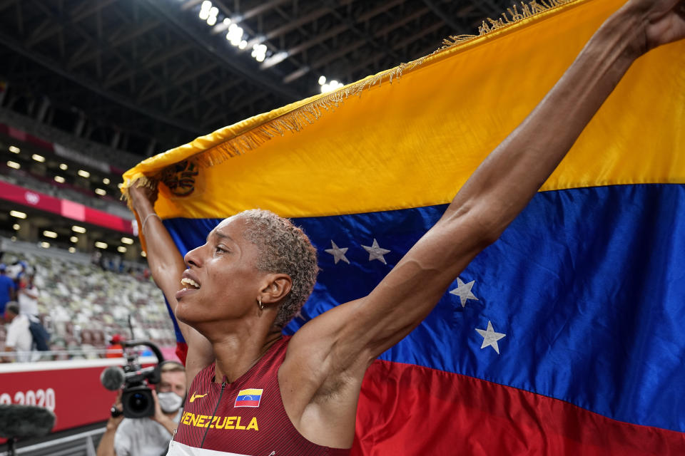 Yulimar Rojas, of Venezuela, celebrates after winning the final of the women's triple jump at the 2020 Summer Olympics, Sunday, Aug. 1, 2021, in Tokyo. (AP Photo/David J. Phillip)