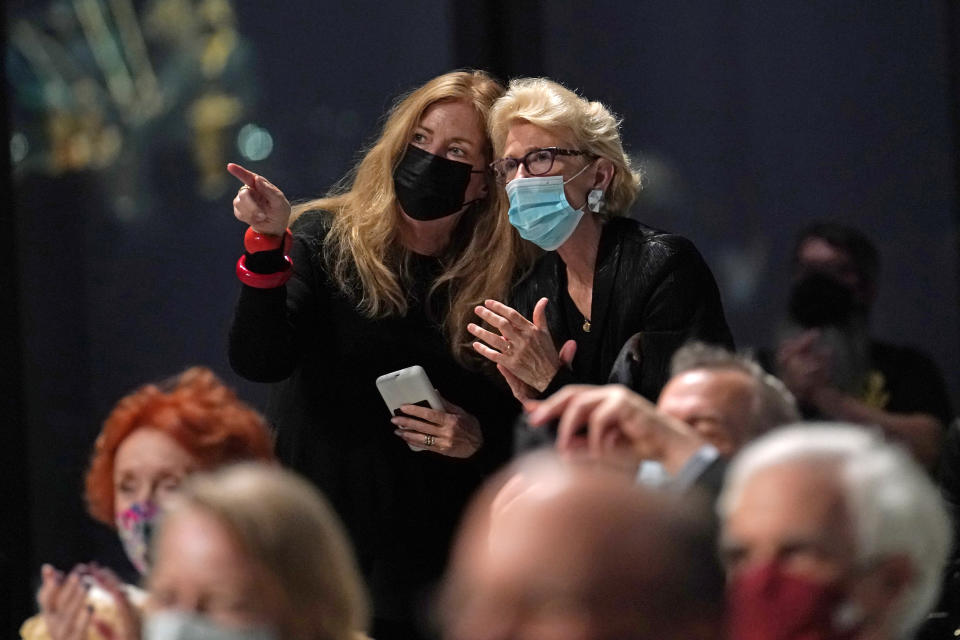 Members of the audience chat at the conclusion of a live performance by the New York Philharmonic after the orchestra performed together before a crowd of 150 socially-distanced spectators for the first time since March 10, 2020, at The Shed in Hudson Yards, Wednesday, April 14, 2021, in New York. (AP Photo/Kathy Willens)