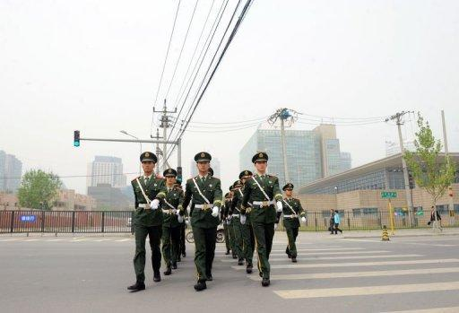 Chinese paramilitary guards march outside the US embassy in Beijing