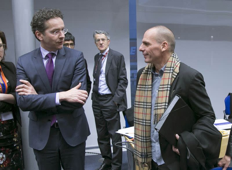 Eurogroup President Dijsselbloem looks at Greek Finance Minister Varoufakis during an extraordinary euro zone Finance Ministers meeting in Brussels