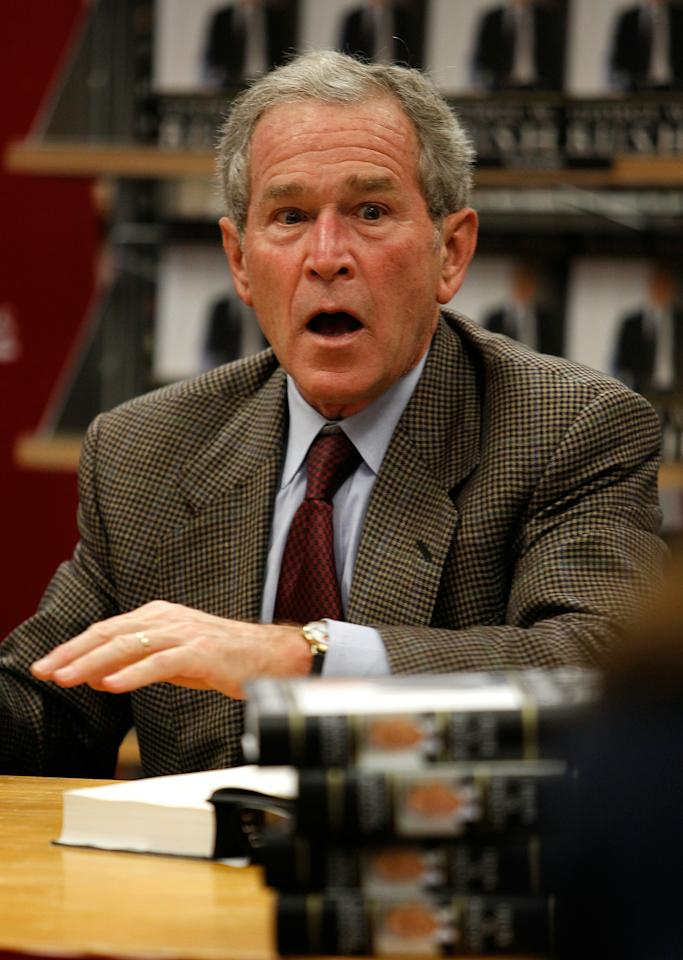 "DALLAS - NOVEMBER 09:  Former U.S. President George W. Bush talks with fans while signing copies of his new memoir ""Decision Points"" at Borders Books on November 9, 2010 in Dallas, Texas. Hundreds of people lined up, starting Monday night, for the chance to purchase signed copies of ""Decision Points"" at the North Dallas bookstore.  (Photo by Tom Pennington/Getty Images)"