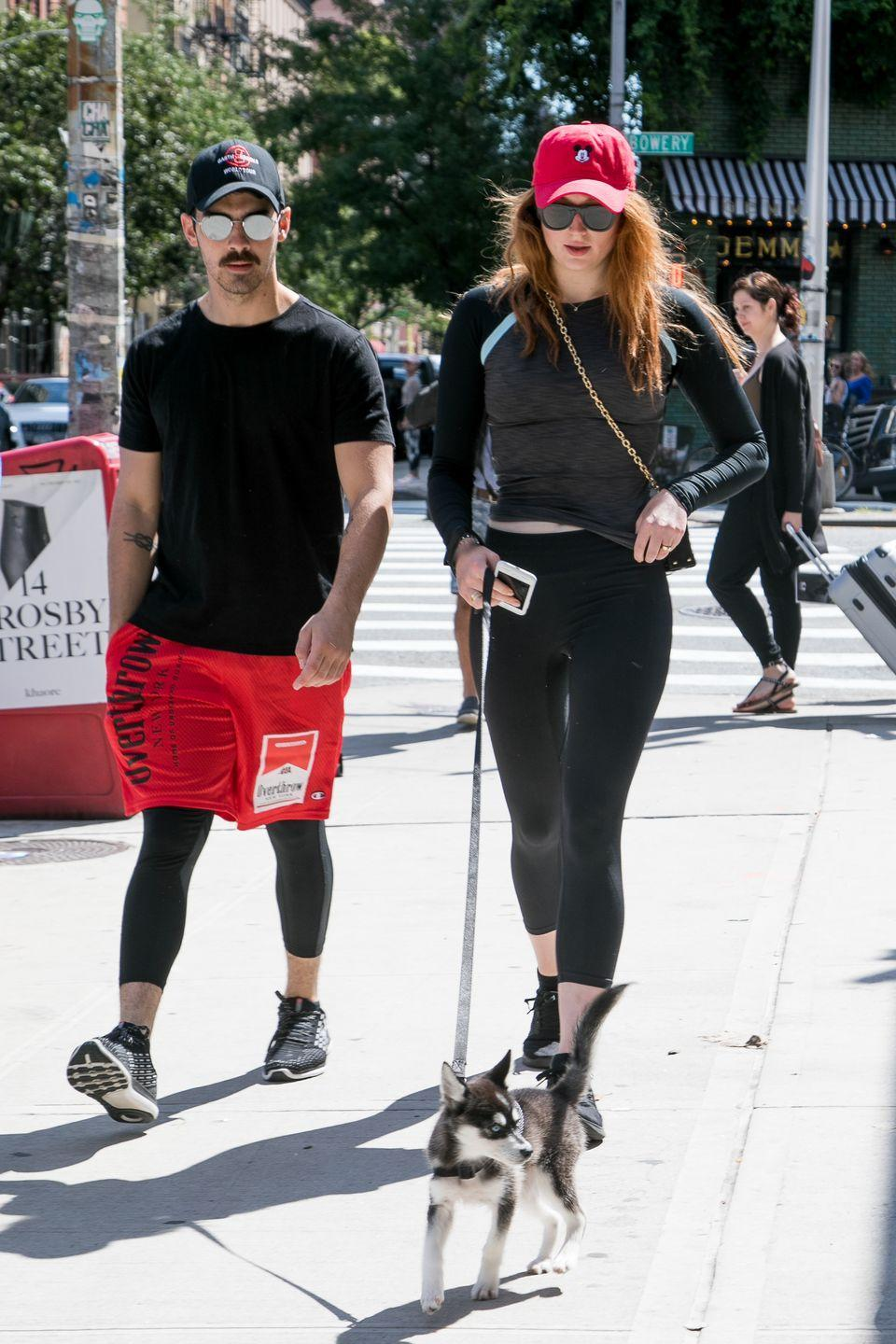 """<p>As things are clearly getting serious for the couple, they choose to <a href=""""https://www.elle.com/uk/life-and-culture/culture/news/a38306/sophie-turner-and-joe-jonas-twosome-has-just-become-a-threesome/"""" rel=""""nofollow noopener"""" target=""""_blank"""" data-ylk=""""slk:get a dog"""" class=""""link rapid-noclick-resp"""">get a dog</a> - Porky Basquit - who goes on to hold<a href=""""https://www.elle.com/uk/life-and-culture/wedding/a28243451/sophie-turner-wedding-dress-joe-jonas-porky-basquit/"""" rel=""""nofollow noopener"""" target=""""_blank"""" data-ylk=""""slk:a key role in their recent wedding."""" class=""""link rapid-noclick-resp""""> a key role in their recent wedding.</a></p><p>They're seen here (with Turner's flame-red hair for her role as Sansa Stark) walking the husky puppy in NYC.</p>"""