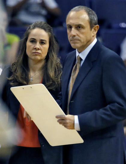 Spurs assistants Ettore Messina (right) and Becky Hammon discuss a play. (AP/Matt York)
