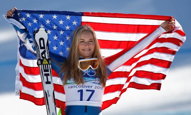 Vonn holds up a flag after winning bronze at the 2010 Winter Olympics.