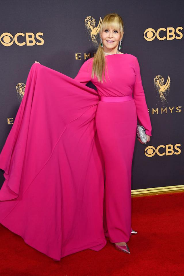 <p>79-year-old Jane Fonda defied her age with a new long hairstyle and a svelte hot pink gown by Brandon Maxwell.<br /><i>[Photo: Getty]</i> </p>