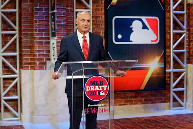 Commissioner Rob Manfred could keep the MLB season going even if one or more teams are forced to drop out. (Photo by Alex Trautwig/MLB Photos via Getty Images)
