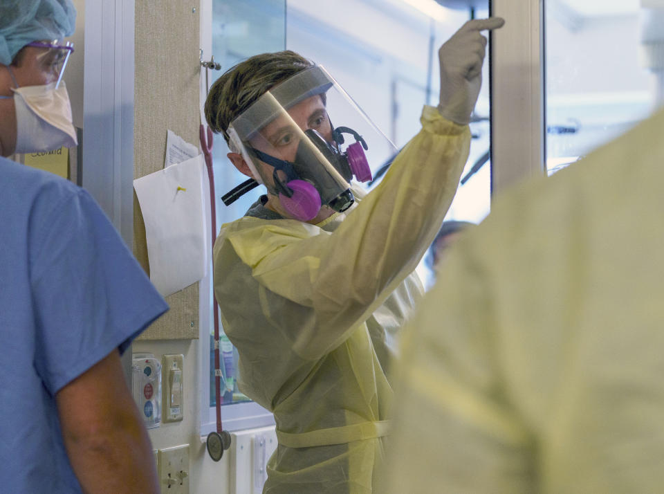 A medical personnel with full protective gear is shown at Salem Hospital in Salem, Oregon, on Friday, Aug. 20, 2021. COVID-19 cases are surging across Oregon, and many hospitals are filled to capacity. (Kristyna Wentz-Graff/Pool Photo via AP)