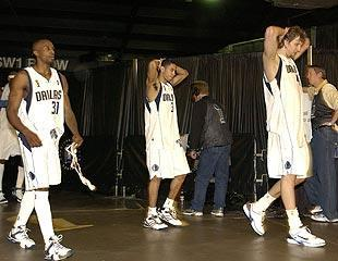 Dirk Nowitzki (right) walks off the court after the Mavs' Finals loss to the Heat in 2006. The Heat insist that Nowitzki is a more dangerous player today