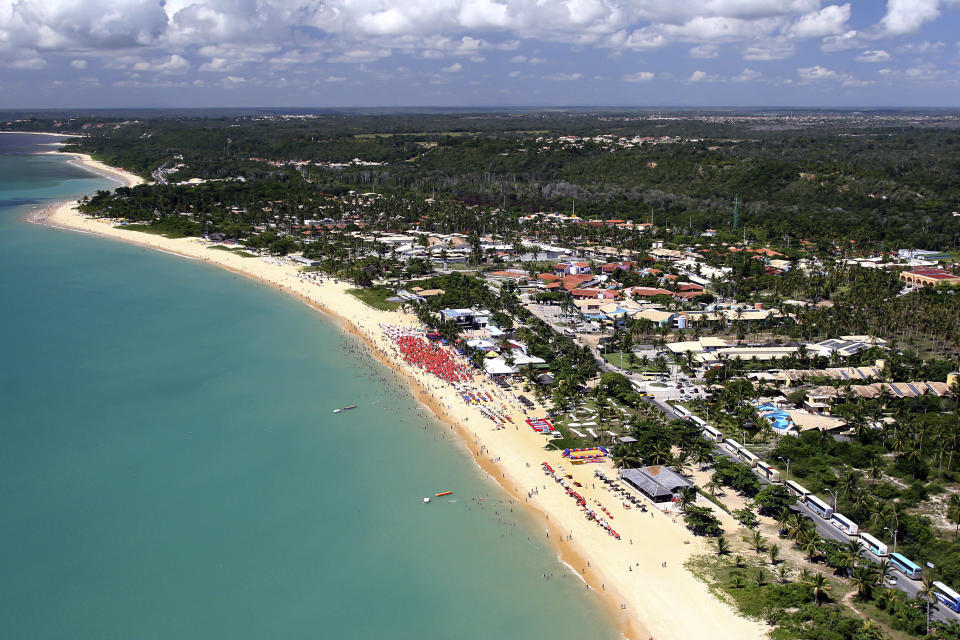 aerial view of coastline of Porto Seguro with green water and blue sky. Bahia, Brazil