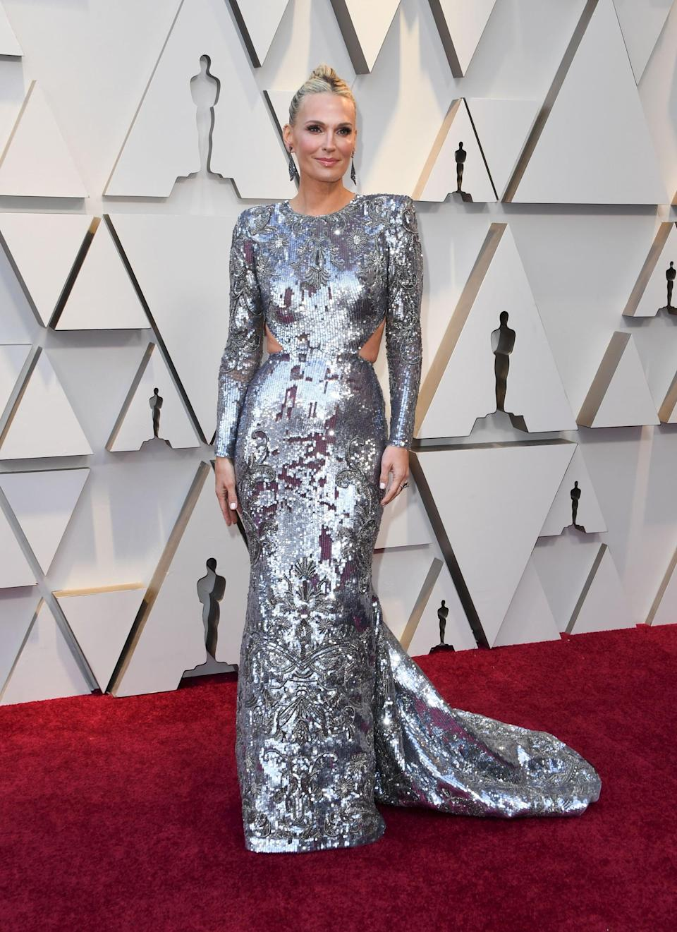 <p>Wearing a Zuhair Murad Couture dress with Stuart Weitzman shoes.</p>