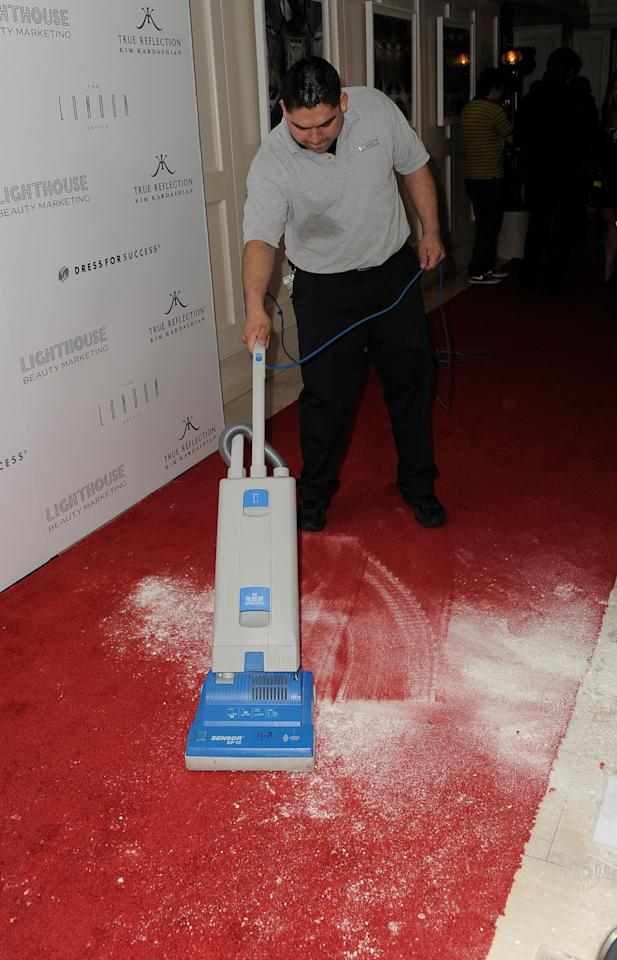 """WEST HOLLYWOOD, CA - MARCH 22:  Workmen clean up after Kim Kardashian is covered in flour at the """"True Reflection"""" Fragrance Launch at The London West Hollywood on March 22, 2012 in West Hollywood, California.  (Photo by Frazer Harrison/Getty Images)"""