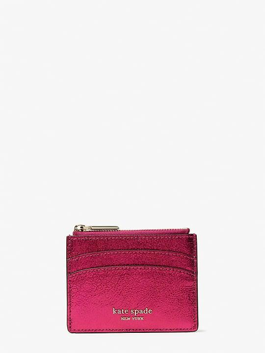 <p>This <span>Kate Spade New York Spencer Metallic Cardholder</span> ($50) is a great find.</p>