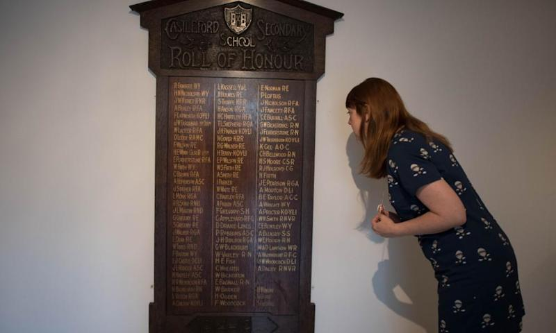 An employee at the Henry Moore Foundation looks at the roll of honour board