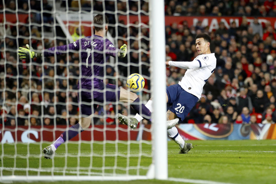 Tottenham Hotspur's Dele Alli scores his side's first goal of the game during the Premier League match at Old Trafford, Manchester. (Photo by Martin Rickett/PA Images via Getty Images)