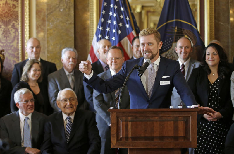 Equality Utah Executive Director Troy Williams (right) speaks after Utah lawmakers introduced a landmark anti-discrimination bill that protects LGBTQ individuals while also carving out protections for the Boy Scouts of America and religious groups during a news conference at the Utah Capitol on March 4, 2015, in Salt Lake City. (THE ASSOCIATED PRESS)
