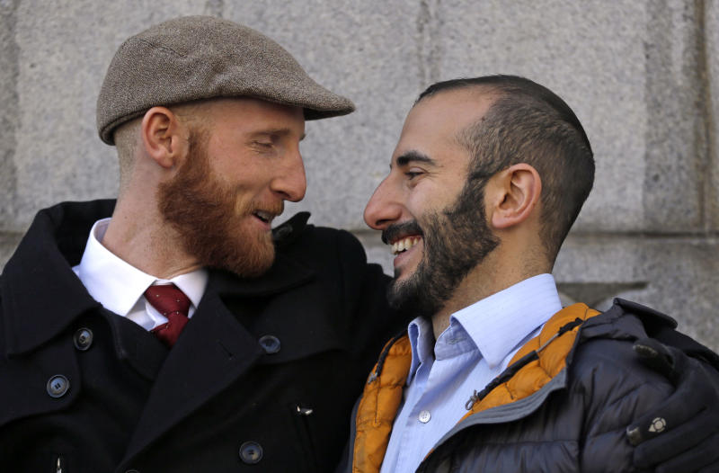 FILE - In this Dec. 4, 2013 file photo, Derek Kitchen, left, and his partner Moudi Sbeity look at each other following court in Salt Lake City. A challenge to Utah's same-sex marriage ban by three gay couples was back in court Dec. 4, as a federal court judge heard arguments. A federal judge struck down Utah's same-sex marriage ban Friday, Dec. 20, 2013, in a decision that brings a nationwide shift toward allowing gay marriage to a conservative state where the Mormon church has long been against it. (AP Photo/Rick Bowmer, File)