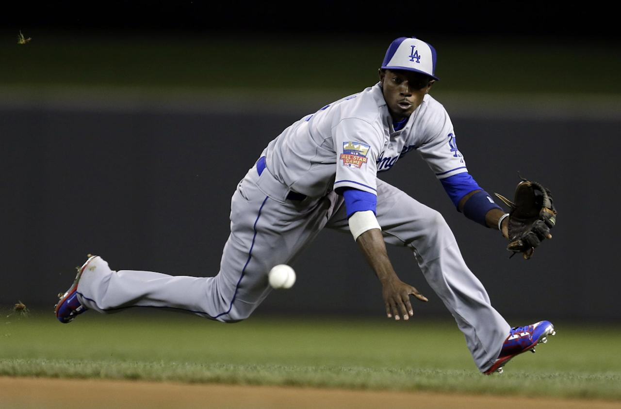 National League second baseman Dee Gordon, of the Los Angeles Dodgers, fields a ground ball hit by American League's Michael Brantley, of the Cleveland Indians, during the seventh inning of the MLB All-Star baseball game, Tuesday, July 15, 2014, in Minneapolis. Gordon threw out Brantley at first base. (AP Photo/Jeff Roberson)
