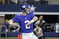 New York Giants quarterback Mike Glennon throws a pass in the second half of an NFL football game against the Dallas Cowboys in Arlington, Texas, Sunday, Oct. 10, 2021. (AP Photo/Michael Ainsworth)
