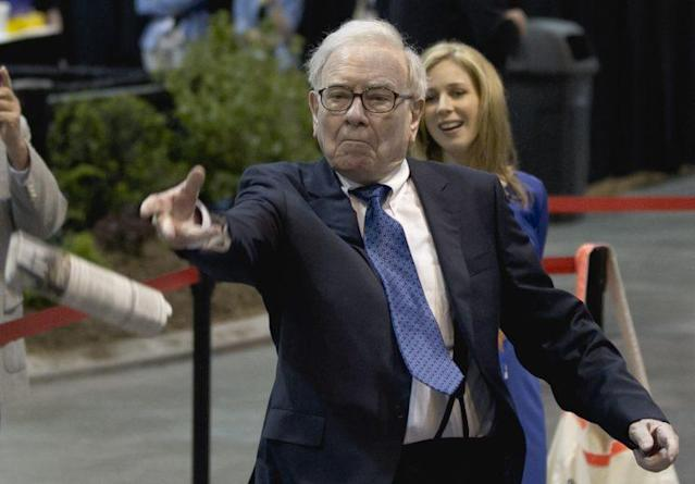 Warren Buffett tosses a newspaper during a competition in Omaha, Neb., Saturday, May 5, 2012. (AP Photo/Nati Harnik)