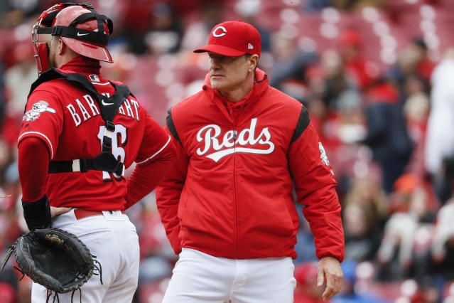 'Cincinnati Reds manager David Bell, right, leaves the mound after releasing starting pitcher Sonny Gray in the third inning of a baseball game against the Pittsburgh Pirates, Sunday, March 31, 2019, in Cincinnati. (AP Photo/John Minchillo)