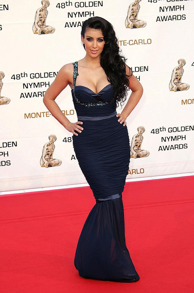 "Kim Kardashian's form-fitting navy dress accentuates her killer curves. Tony Barson/<a href=""http://www.wireimage.com"" target=""new"">WireImage.com</a> - June 12, 2008"