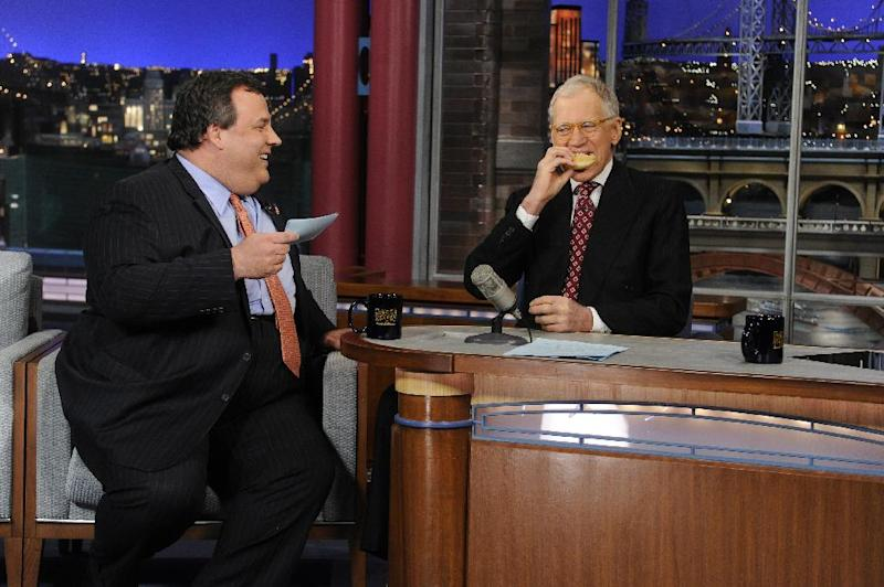 "In this photo released by CBS Broadcasting, New Jersey Gov. Chris Christie, left, chats with David Letterman, right, during his first visit to CBS' ""Late Show with David Letterman,"" on Monday, Feb. 4, 2013 in New York. (AP Photo/CBS Broadcasting, Jeffrey Neira)"