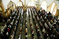 Muslims gather to pray at a mosque in Lhokseumawe, Aceh