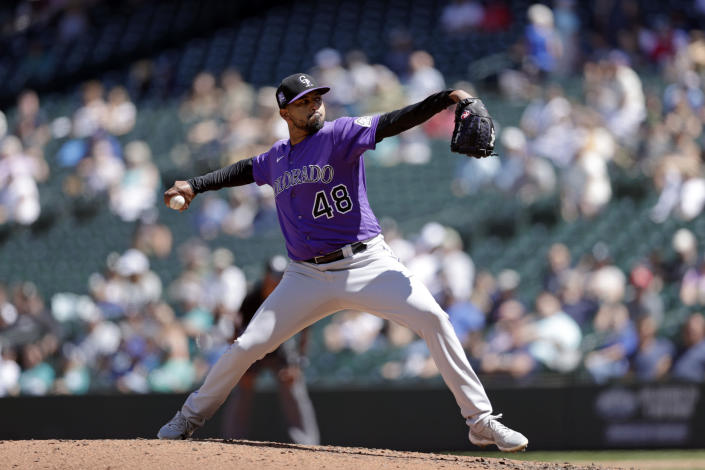 Colorado Rockies starting pitcher German Marquez works against the Seattle Mariners during the fifth inning of a baseball game, Wednesday, June 23, 2021, in Seattle. (AP Photo/John Froschauer)