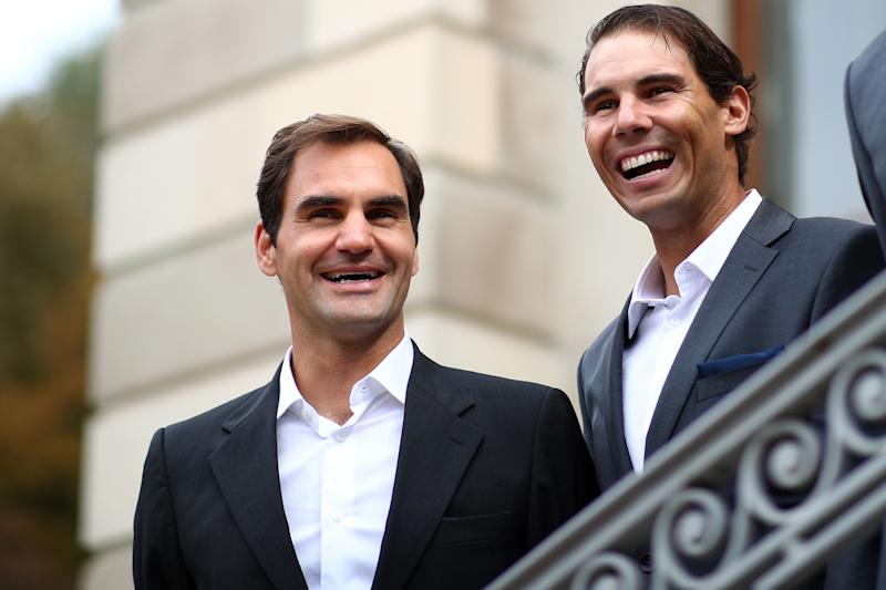 GENEVA, SWITZERLAND - SEPTEMBER 18: Roger Federer and Rafael Nadal of Team Europe react as they are presented to the crowd at Palais Eynard during the official welcome ceremony prior to the Laver Cup 2019 at Palexpo, on September 18, 2019 in Geneva, Switzerland. The Laver Cup will see six players from the rest of the World competing against their counterparts from Europe. Team World is captained by John McEnroe and Team Europe is captained by Bjorn Borg. The tournament runs from September 20-22. (Photo by Julian Finney/Getty Images for Laver Cup)