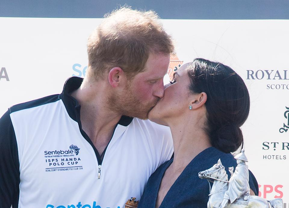 WINDSOR, ENGLAND - JULY 26:  Prince Harry, Duke of Sussex and Meghan, Duchess of Sussex kiss at the trophy presentation at the Sentebale Polo 2018 held at the Royal County of Berkshire Polo Club on July 26, 2018 in Windsor, England.  (Photo by Samir Hussein/Samir Hussein/WireImage)