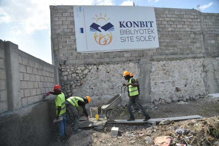 Workers are seen at the site of a future library in Cite Soleil, a slum in the Haitian capital Port-au-Prince -- a project funded by local residents