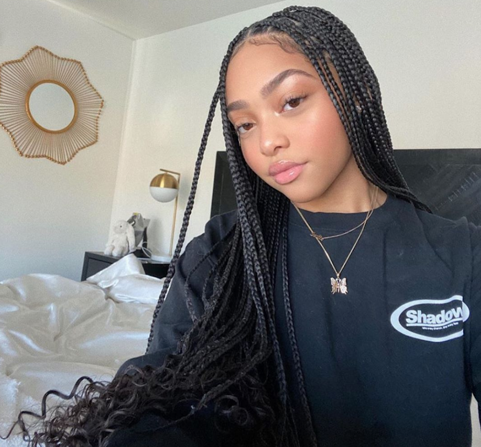 Add curly extensions to box braids to kick them up a notch.
