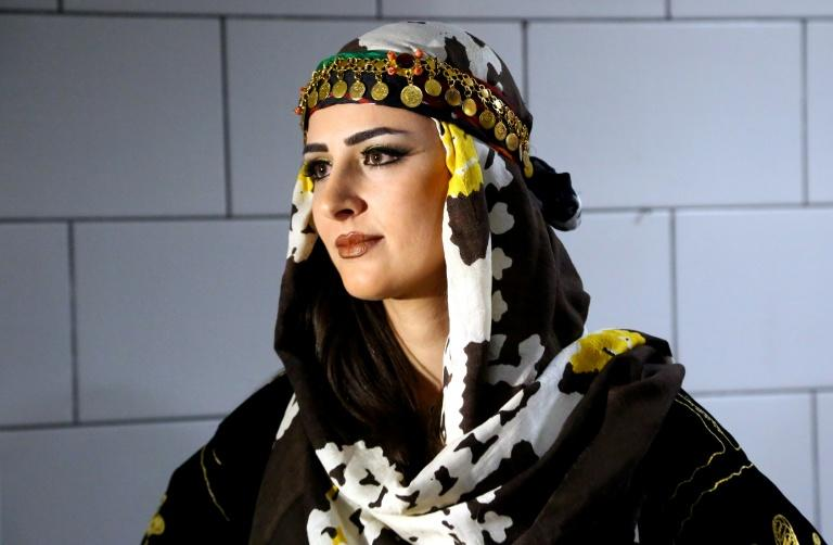 Efin Hissu models traditional Syrian-Kurdish clothes, dress that can now be openly displayed in Kurdish-majority areas