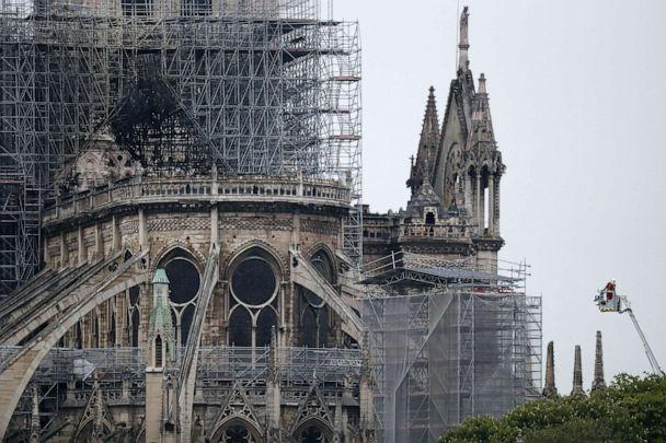 PHOTO: A firefighter stands in an aerial lift near the burnt roof after a massive fire destroyed the roof of the Notre-Dame Cathedral in Paris, April 16, 2019. (Ian Langsdon/EPA via Shutterstock)