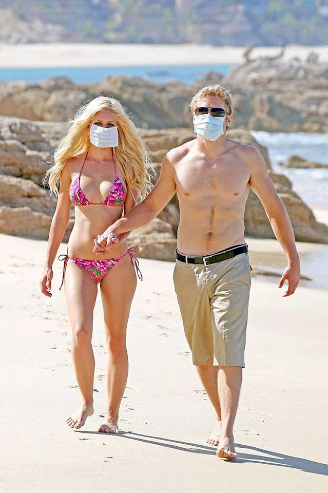 "Attention-starved newlyweds Heidi Montag and Spencer Pratt battled swine flu during their honeymoon in Cabo San Lucas, Mexico, by sporting unsightly surgical masks along with their swimsuits. Kevin Perkins/<a href=""http://www.pacificcoastnews.com/"" target=""new"">PacificCoastNews.com</a> - April 28, 2009"