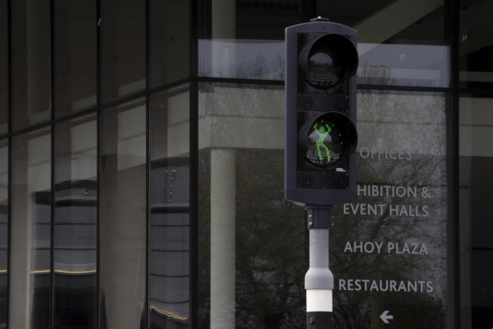 In this photo taken on May 16, 2021 traffic light with a dancing figure plays Abba's Waterloo for pedestrians heading towards the Eurovision Song Contest at Ahoy arena in Rotterdam, Netherlands. After last year's Eurovision Song Contest was canceled amid the global COVID-19 pandemic, it is roaring back to life with coronavirus bubbles added to its heady mix of music and camp. (AP Photo/Peter Dejong)