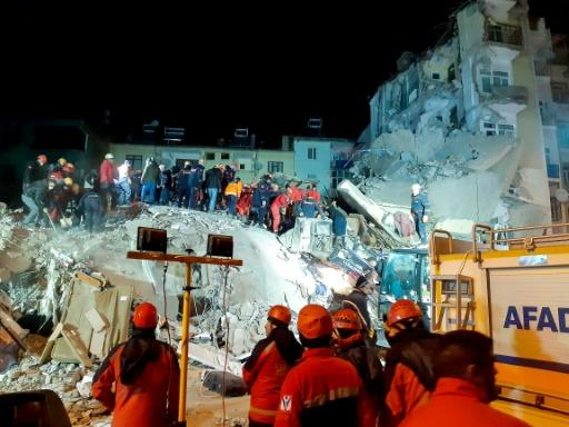 The rescue efforts have been taking place in freezing temperatures as wood and plastic were burned to keep crowds warm