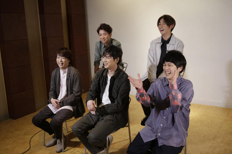 Members of Japanese pop music band ARASHI listen to a question during an interview with The Associated Press in Tokyo on Thursday, Sept. 17, 2020. Back row, from left, clockwise, are Satoshi Ohno, Masaki Aiba, Kazunari Ninomiya, Jun Matsumoto and Sho Sakurai. Japanese pop sensation Arashi has a big surprise for fans as they near their planned hiatus at year's end: a collaboration with Bruno Mars on their first all-English single. (AP Photo/Hiro Komae)